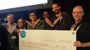 xMatters engineers with a winning check at the AT&T hackathon